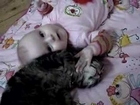 Baby and cat love each other